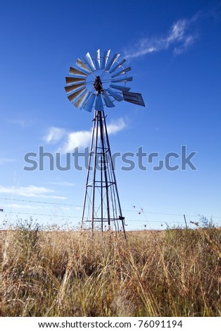 Windmill with sun rising blue sky - stock photo