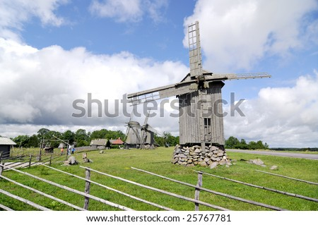 windmills against blue sky - stock photo