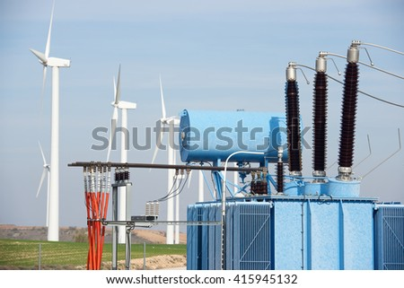 Windmills and electrical substation, Zaragoza province, Aragon, Spain. - stock photo