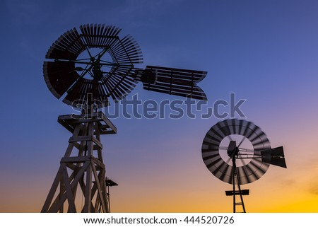 Windmills at dusk - stock photo