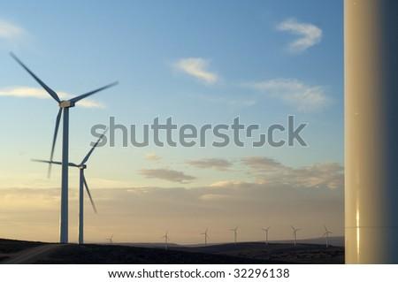 windmills at sunset - stock photo
