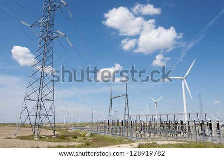 windmills for  electric power production and  electrical substation in La Muela, Saragossa, Aragon, Spain - stock photo