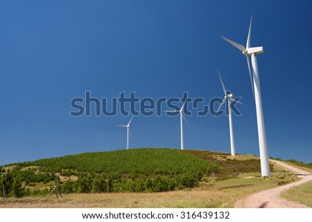 Windmills for electric power production, Burgos Province, Castilla Leon, Spain. - stock photo
