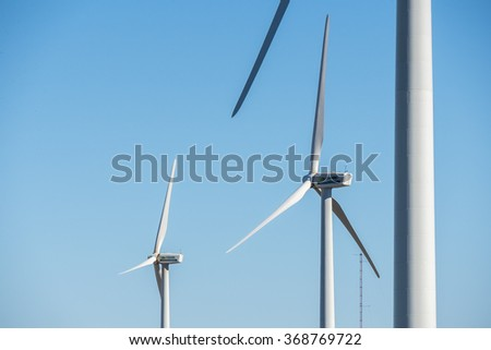Windmills for electric power production, eco power, wind turbines - stock photo