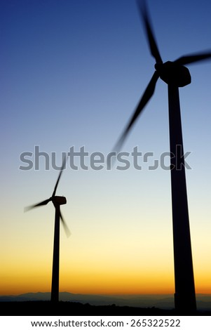 Windmills for electric power production, La Muela, Zaragoza Province, Aragon, Spain. - stock photo