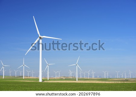 Windmills for electric power production, Zaragoza province, Aragon, Spain - stock photo