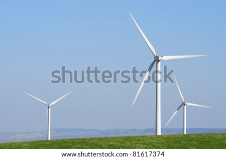windmills for renowable electric production with blue sky - stock photo