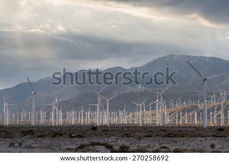 windmills form part of the desert landscape in the San Gorgonio pass in Southern California - stock photo
