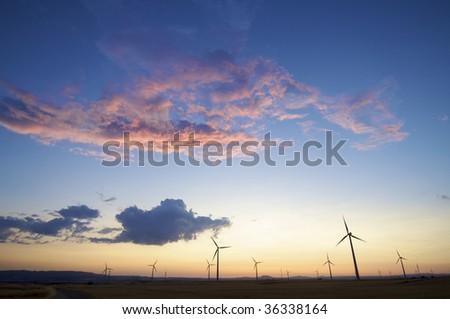 windmills group with colorful sky
