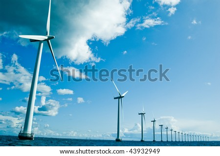 Windmills in a row horizontal - stock photo