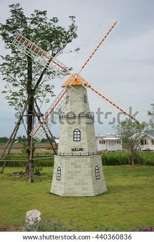 windmills in farm - stock photo