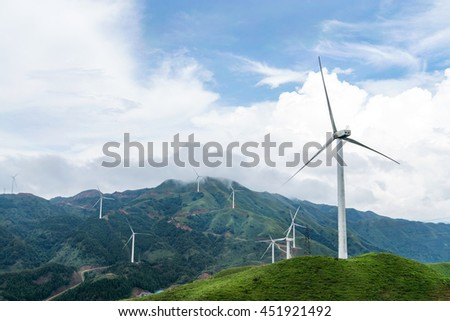 Windmills in the background of the blue sky white clouds