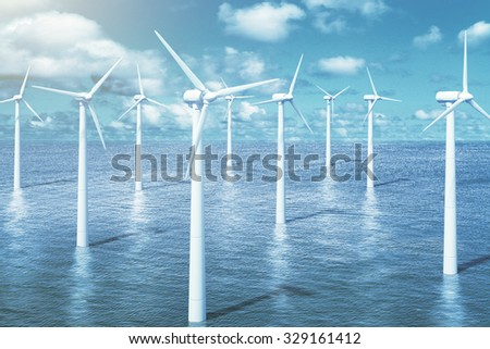 Windmills in the water with sky background - stock photo