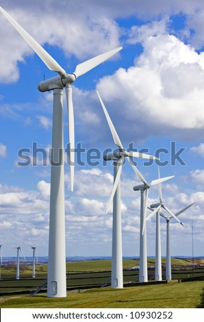 Windmills in wind-farm - stock photo