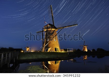 Windmills of Kinderdijk at night with startrail, the Netherlands. - stock photo