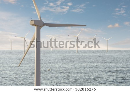Windmills offshore windpark for electric energy.  - stock photo