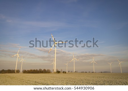 windmills on a frosty, winter field