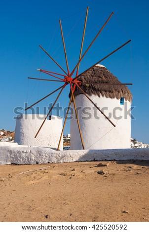 Windmills on a hill near the sea on the island of Mykonos - stock photo