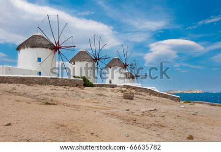 Windmills on a hill near the sea on the island of Mykonos - a famous place.