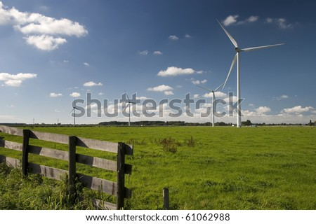 Windmills on dutch meadow - stock photo