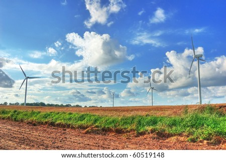 Windmills on the green field. - stock photo