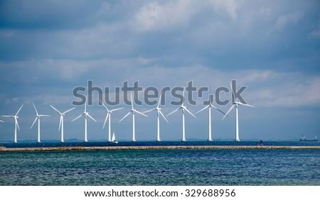 Windmills on the sea - stock photo