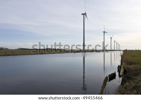 Windmills reflected in water - stock photo