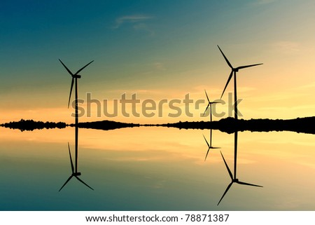Windmills silhouette on suset background