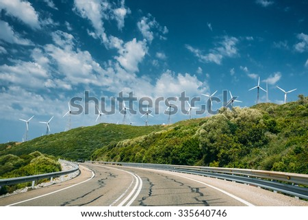 Windmills, wind turbines for electric power production and highway in Spain - stock photo
