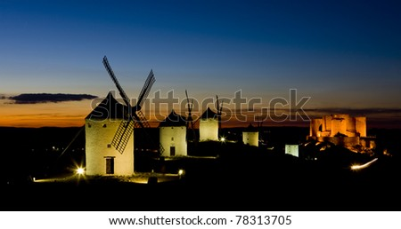 windmills with castle at night, Consuegra, Castile-La Mancha, Spain - stock photo
