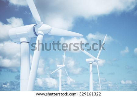 Windmills with the sky background and clouds - stock photo