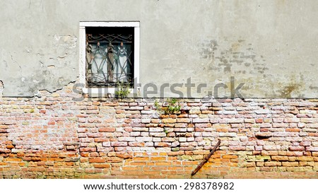 window and ancient decay wall half brick wall building architecture in Murano, Venice, Italy - stock photo