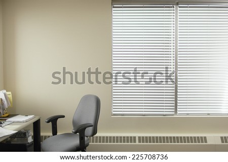 Window and chair in office - stock photo