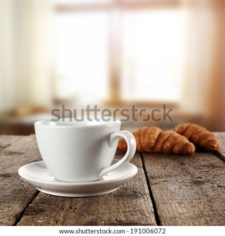 window and coffee with croissants  - stock photo