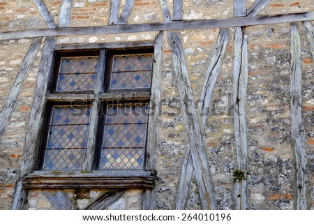 Window and facade beams of medieval house - stock photo