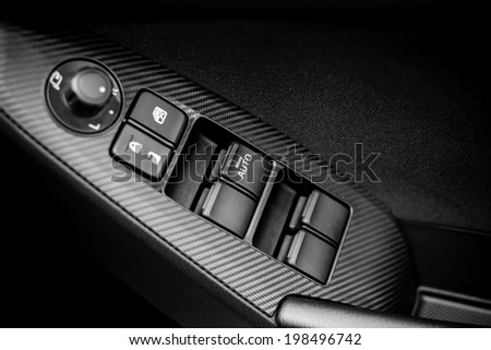 Window and mirror control panel on driver's door, detail of modern car , black and white - stock photo