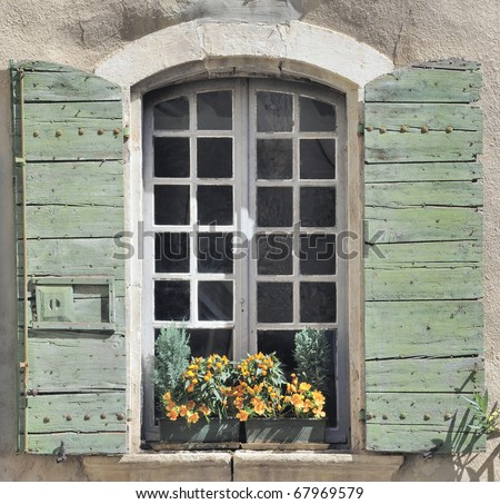 Window and shutters in old house, Provence, France