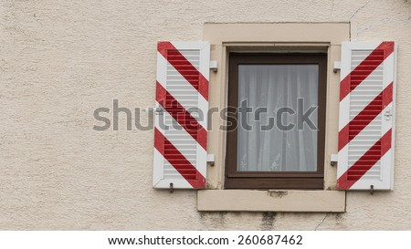 Window and shutters on the facade of an old residence in the heart of Freiburg, Germany - stock photo