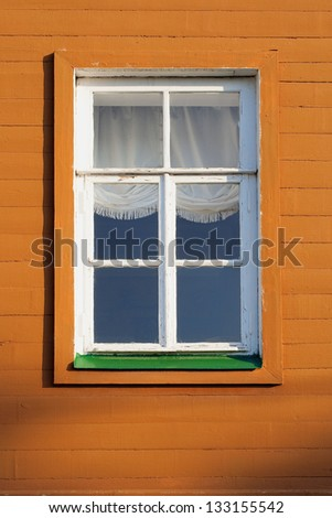 Window and wall fragment of the old wooden house - stock photo