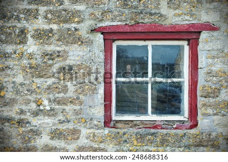 Window and Wall of an Old Stone Cottage House - stock photo