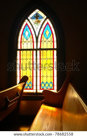 Window and wooden pew in a small church built in 1901; Redlands, California - stock photo
