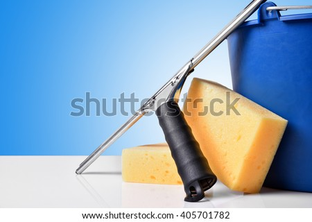 Window cleaning tools on white table. Front view. Horizontal composition - stock photo