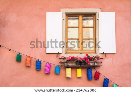Window decorated with colorful lamps during the wine feast, Eguisheim, Alsace, France - stock photo