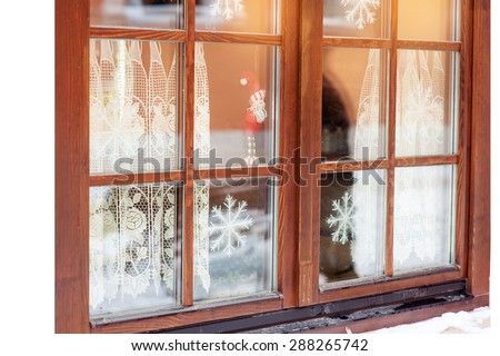 window decorated with snowflakes in winter.