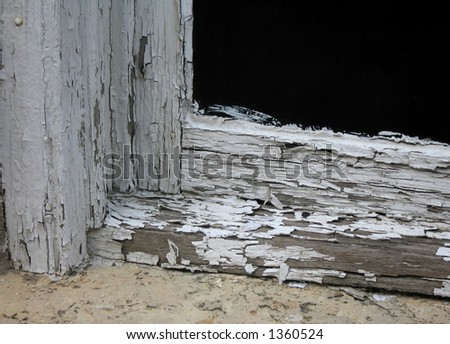 window frame in dire need of maintenance - stock photo