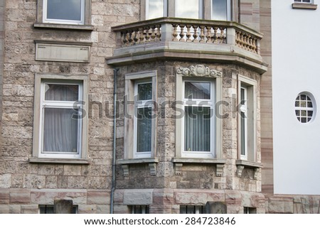 Window front of a nice old building villa - stock photo