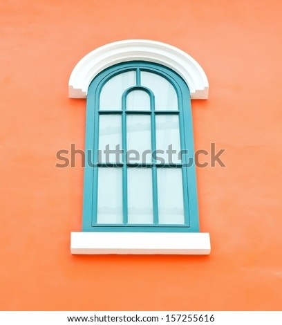 Window green on orange wall