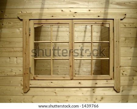 Window in a natural wood cabin - stock photo