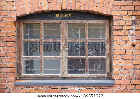 Window in a red brick wall - stock photo