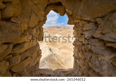 Window in a wall in the Columbarium tower on Masada in Israel - stock photo